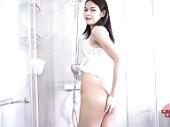 Sexy Pon has a hot slim body, small natural breasts, a sexy ass and a delicious uncut cock! See this hot Grooby girl soaping up in the shower before she jerks off and cums!